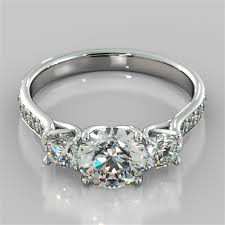 round cut three stone trellis engagement ring