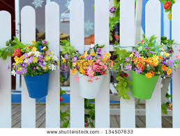 Flower Pots - hanging flower pots fence stock photo 134507663 shutterstock