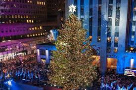 rockefeller center tree lights up amid rainy weather ny daily news