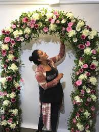 flower arch learn to make a floral arch floral pillars floral chandeliers