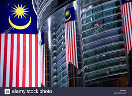 Malaysai Flag The Flag Of Malaysia Hangs Vertical Next To The Facade Of The