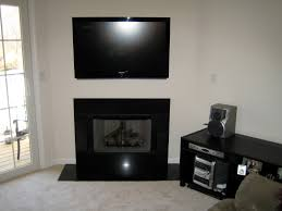 corner wall mount tv stand over fireplace added black stained wooden a cabinet with shelf with mounting tv above fireplace stone also mounting tv above