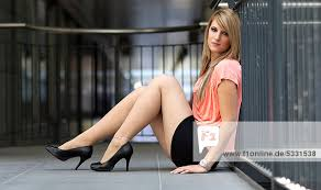 Short Skirts High Heels Young Woman Wearing A Mini Skirt And High Heels Sitting On The
