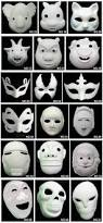 white paper mache different design of face masks for kid to paint