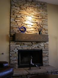 elegant stone fireplace building with image design beside