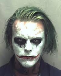 joker halloween mask man carrying a sword dressed as joker arrested in virginia
