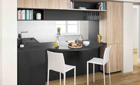 cuisine surface cuisine moderne noir et bois ouverte ambiance rétro mobalpa