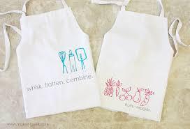 aprons with heat transfer vinyl doodles plus a silhouette