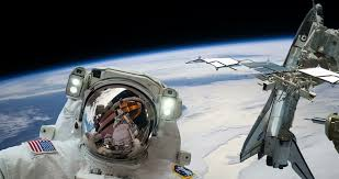 space shuttle astronaut astronaut spacewalk with space shuttle on space station over earth