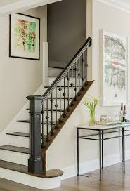 Dark Wood Banister Entryway With Stairs Staircase Traditional With Framed Art Wood