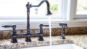 how to change a kitchen faucet how to replace a kitchen faucet angie s list
