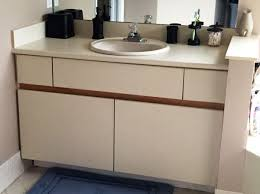laminate veneer over existing cabinet diy inexpensive bathroom cabinet makeover paint laminate cabinets