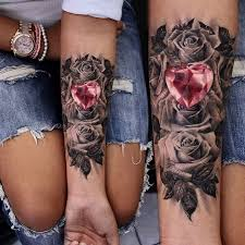 picture of black roses and a matching tattoos