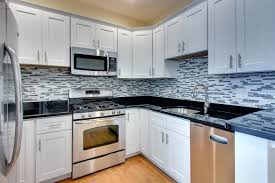 glass tile backsplash with white cabinets kitchen grey grey