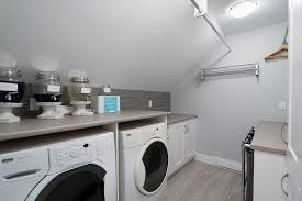 Small Attic Bathroom Sloped Ceiling by Laundry Room Sloped Ceiling Design Ideas