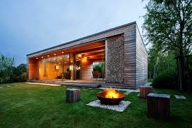 modern cabin design and this wooden cabin with folding glass doors