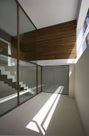 corner frameless with pink entrancing interior glass walls for