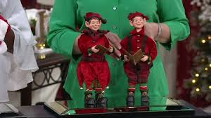 choice of caroling elves or santa and mrs claus by valerie qvc
