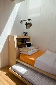 small scandinavian bedroom with custom platform trundle bed and