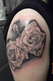 rose with black background tattoo and grey angel with clock red