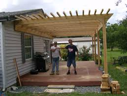 Building A Pergola Attached To The House by Attached Pergola Designs Pictures