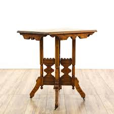 this eastlake style side table is featured in a solid wood with a