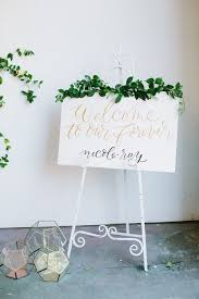 wedding backdrop sign white easel wedding sign http ruffledblog winter wedding