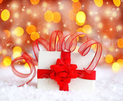 warm holiday background with white present gift box wrapped with