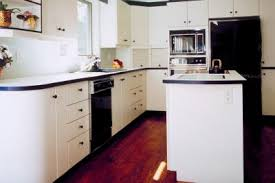 white kitchen cabinets yellow walls how to keep white cabinets from yellowing