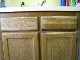 Kitchen Cabinet Restaining by Peeling And Painting Laminate Kitchen Cabinets 25 Best Ideas