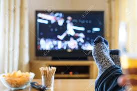 television tv watching basketball game with feet on table