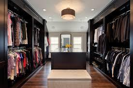 walk in closet lighting shoe storage ottoman in closet transitional with walk through closet