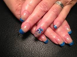 blue colored acrylic with hand painted nail art design hand