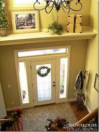 Decorating The Entrance To Your Home Add A Shelf Above The Door To Break Up The Large Wall Space In A
