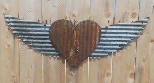 up cycled corrugated metal wings with heart