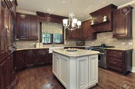 Granite Island Kitchen Kitchen In Luxury Home With White And Granite Island Stock Photo