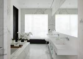 white white marble wall and white floating bathroom sinks also