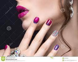 beautiful fashion woman color face art fenix style and nail desi