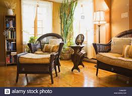 wicker furniture in living room of 19th century cottage style home