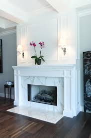Decorating Around A Corner Fireplace Dark Hardwood Floors Pair With A Striking Marble Fireplace In This