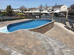 radiant semi inground oval on the waterfront radiant pools