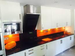smartpack kitchen design pure orange with horizontal mirror stripe kitchen glass splashback