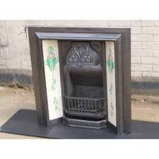 antique original victorian cast iron fireplace with tiles