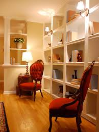 how to decorate living room walls functional and stylish wall to wall shelves hgtv