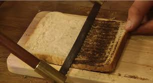 Toasting Bread Without A Toaster Furzotoasto Is A Knife That Doubles Up As A Toaster Daily Mail