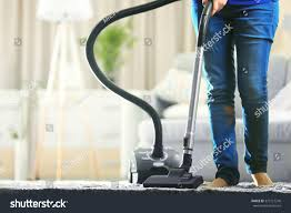 woman cleaning carpet vacuum cleaner living stock photo 373127248