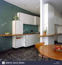 Kitchen Green Kitchen Colors Stock Pale Wood Dining Table And Chairs In A Dark Green Kitchen With