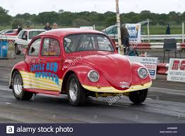modified volkswagen beetle heavily modified vw beetle competing in drag race stock photo