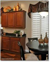 How To Decorate Your Kitchen by Decorate Above Kitchen Cabinets Home Decor Decorating Above The