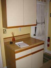 which is better for cabinet refacing laminate or wood brown